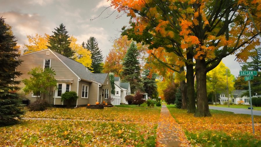 A quiet village street in autumn. 5 Reasons to Schedule a Fall Furnace Clean and Check.